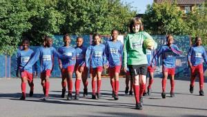 children-walking-in-football-kit
